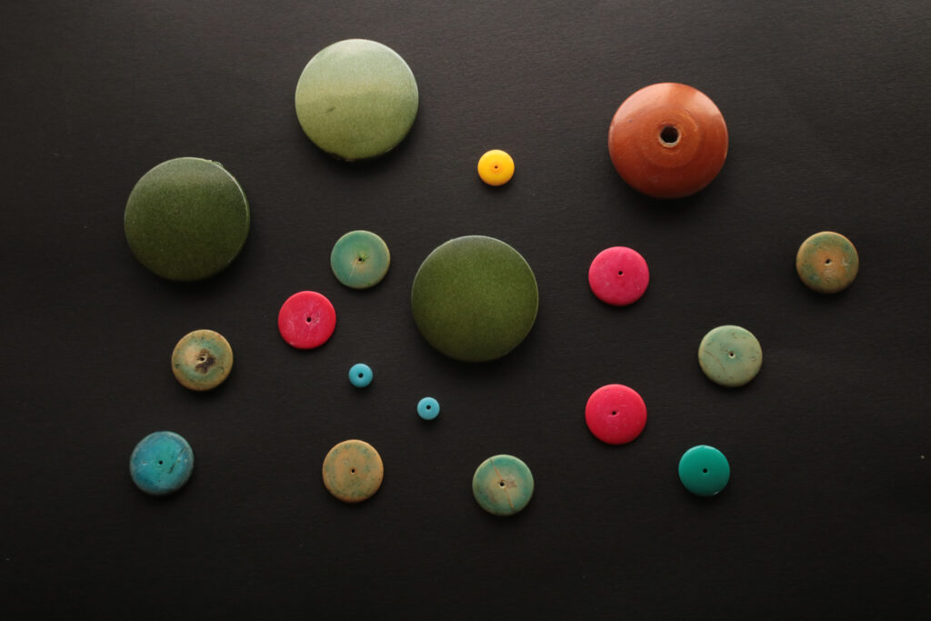 assorted round buttons of various sizes and colors