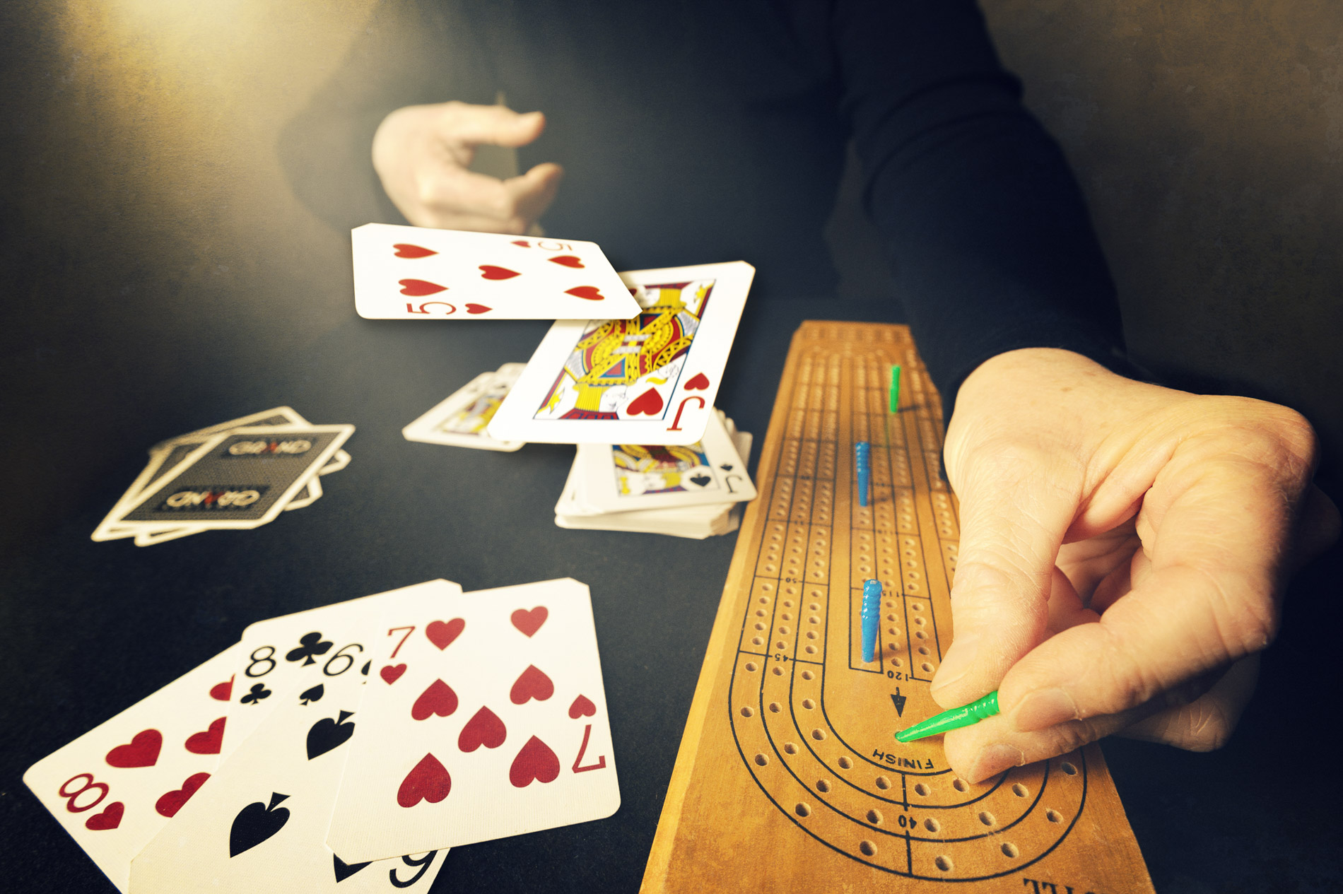 person counting pegs in a cribbage card game