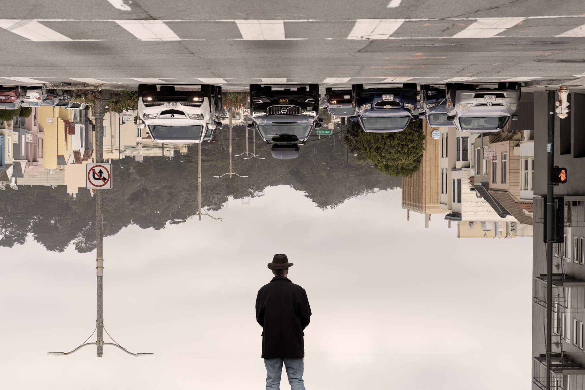 man in front of upside down city